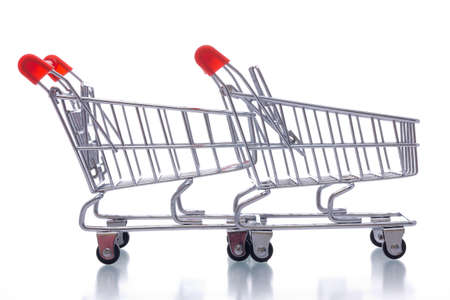 two shopping  carts  isolated  on white background Stock Photo