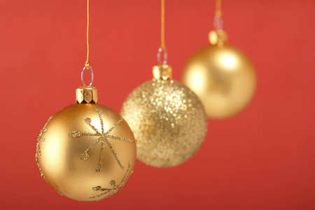 Gold Christmas Balls Isolated  On Red Background photo