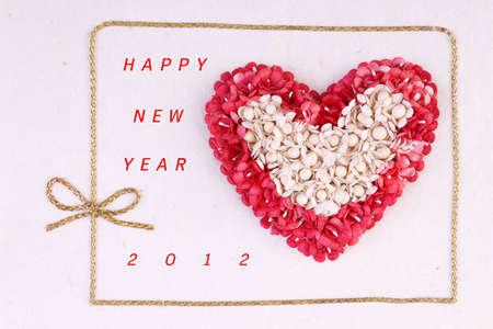 Handmade Red Heart Happy New Year 2012 Card Stock Photo - 11494221
