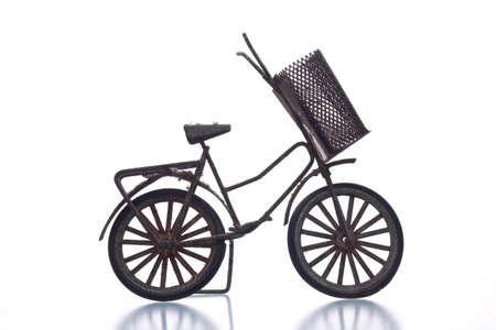 vintage model bicycle isolated on white  background photo