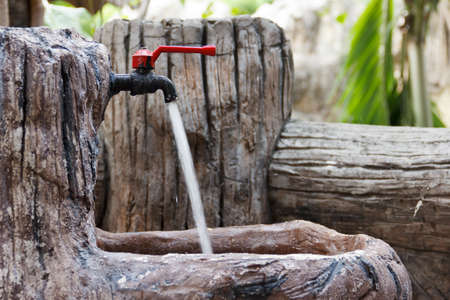 old water tap in the park photo