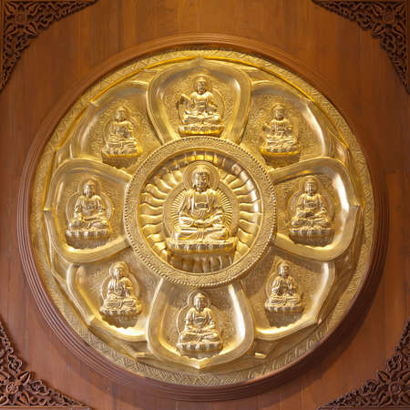 golden buddhas arranged in a circle photo