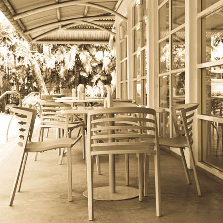 cozy cafe terrace in sunny garden photo