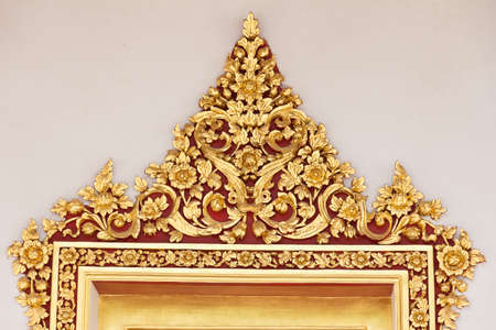 golden stucco decorated on the arch of  ancient temple Stock Photo - 12966958