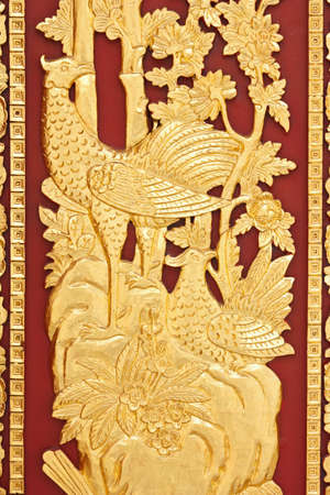golden swan on red wood background photo