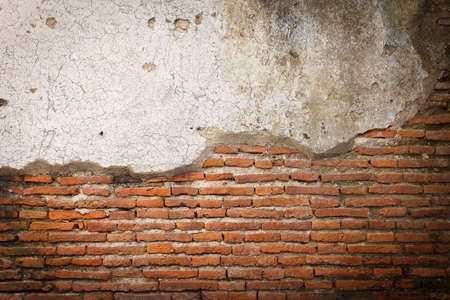 decayed old brick wall as background Stock Photo - 13449411