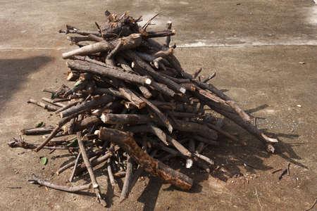 wood stick: pile of  firewood on concrete floor