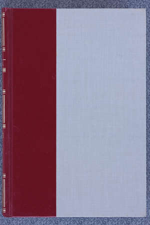 treatise: old hardcover book on gray background