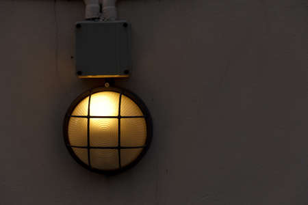 wall mounted lamp on concrete wall