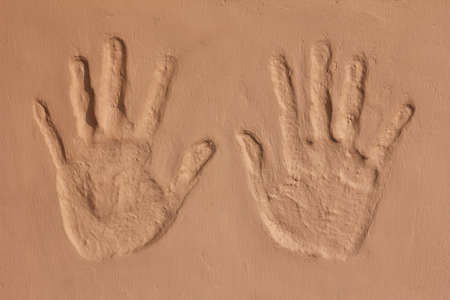 hand imprint on concrete wall photo