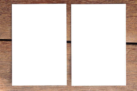 blank photo paper on old wood background Stock Photo