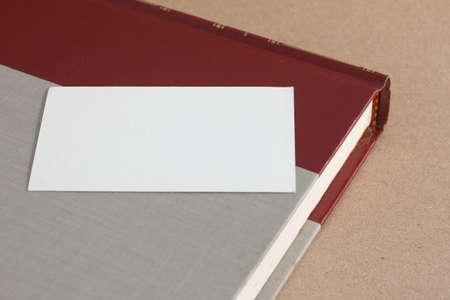 old hardcover book with blank white card