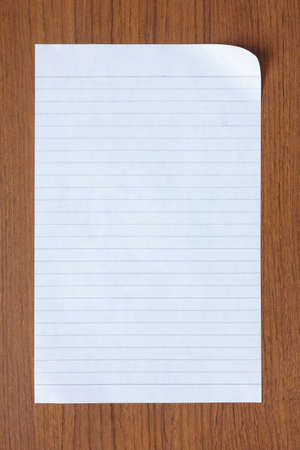 blank white paper on old wood background Stock Photo