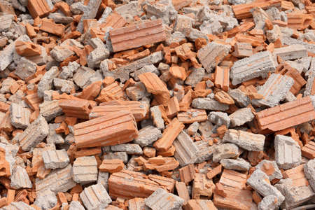 pile of collapsed red bricks wall