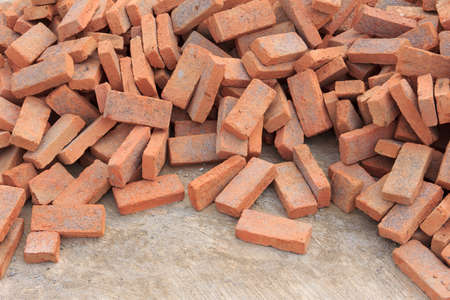 pile of red brick as background Stock Photo