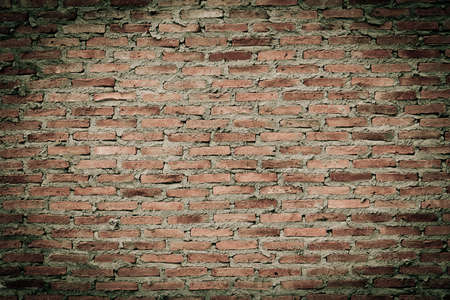 old red brick wall texture as background photo