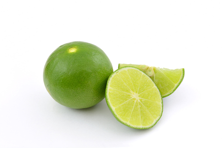 lemon wedge: Limes with slices isolated on white background