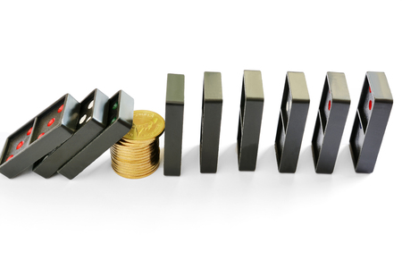 Golden coins stack stopping the dominoes effect continuous toppled, business risk concept Stock Photo