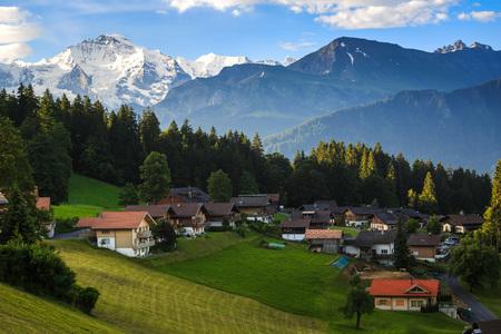 jungfraujoch: Village at Beatenberg with Jungfraujoch in background Stock Photo