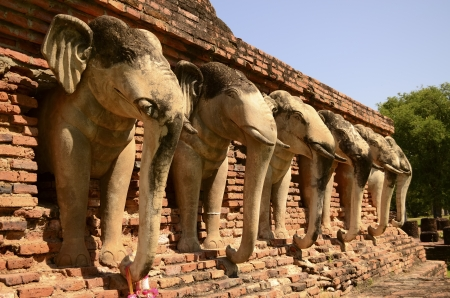 elephant statue around pagoda at ancient temple   Wat Chang Lom  at Sukhothai historical  Thailand photo