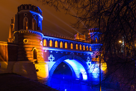 the tsaritsyno: Tsaritsyno, Moscow, Russia - October 11, 2014: the international festival Circle of Light, Illuminated Bridge.