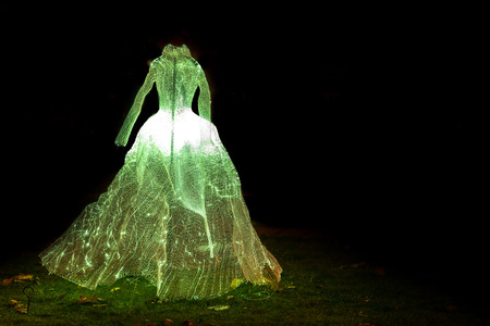 the tsaritsyno: Tsaritsyno, Moscow, Russia - October 11, 2014: the international festival Circle of Light, Illuminated wedding gown.