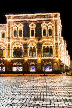 universally: Autumn 2014. Evening. Russia. Moscow. GUM with backlight. View from the side Ilyinka Street.?GUM is the main universally store in many cities of the former soviet union. Editorial