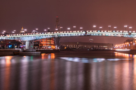 patriarchal: Autumn 2014. Russia. Moscow. Embankment of the Moscow river. The Patriarchal Bridge (Patriarshy Bridge). View from the Embankment of the Moscow river.??Patriarchal Bridge (Russian: Patriarshy Most) is a steel pedestrian box girder bridge that spans Moskva Editorial