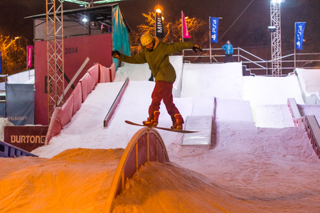 named: Winter 2014. Evening. Russia. Moscow. Central Park of Culture and Rest named after Gorkiy. The Man training in the SnowPark.
