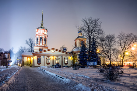 Winter 2014. Russia. Moscow. Altufyevo. The Church of the exaltation of the Holy cross in Altufevo (Holy cross Church, the Church of the exaltation). View of the Temple from the gate of the main entrance. photo