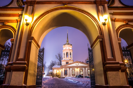 exaltation: Winter 2014. Russia. Moscow. Altufyevo. The Church of the exaltation of the Holy cross in Altufevo (Holy cross Church, the Church of the exaltation). View of the Church through the entrance arch. Stock Photo