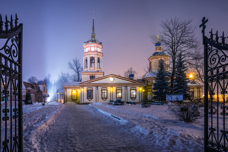 exaltation: Winter 2014. Russia. Moscow. Altufyevo. The Church of the exaltation of the Holy cross in Altufevo (Holy cross Church, the Church of the exaltation). View of the Temple from the gate of the main entrance. Stock Photo