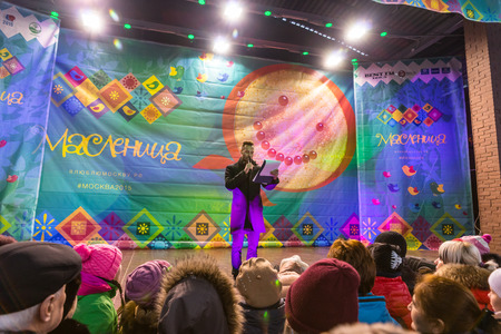 pancake week: Winter 2015. Day. Russia. Moscow. Maslenitsa (pancake week). The host announces the beginning of the competition. Editorial