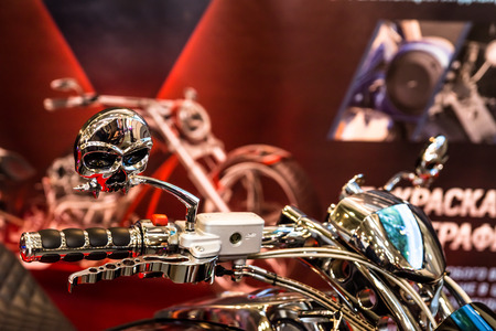 original bike: Winter 2015. Morning. Russia. Moscow. Crocus-Expo. Exhibition  Motopark-2015 (BikePark-2015). The exhibition stand of the tuning studio for motorcycles MGS-Moto.  Handlebar of the motorcycle with the original design.