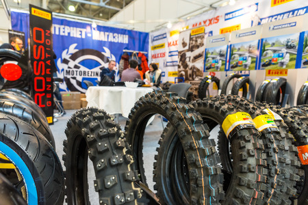 winter tires: Winter 2015. Morning. Russia. Moscow. Crocus-Expo. Exhibition Motopark-2015 (BikePark-2015). The exhibition stand of online store of Moto tires.