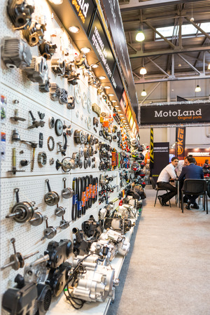 spare parts: Winter 2015. Morning. Russia. Moscow. Crocus-Expo. Exhibition Motopark-2015 (BikePark-2015). The exhibition stand of MotoLand. The stand with spare parts. Editorial