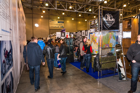 visitors: Winter 2015. Morning. Russia. Moscow. Crocus-Expo. Exhibition Motopark-2015 (BikePark-2015). Visitors are walking trough exhibition.