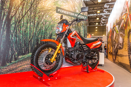 forester: Winter 2015. Morning. Russia. Moscow. Crocus-Expo. Exhibition Motopark-2015 (BikePark-2015). The exhibition stand with motorcycle Racer Forester RC200LT.