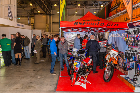 Winter 2015. Morning. Russia. Moscow. Crocus-Expo. Exhibition Motopark-2015 (BikePark-2015). Visitors are walking through the exhibition, they are watching the exhibition stands.