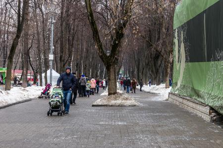 maslenitsa: Winter 2015. Day. Russia. Moscow. Maslenitsa (pancake week). The Celebration of Maslenitsa (pancake week). The people are walking in the Park before starting entertainment program of the Holiday.