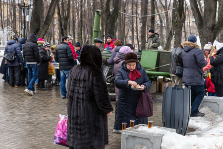 pancake week: Winter 2015. Day. Russia. Moscow. Maslenitsa (pancake week). The Celebration of Maslenitsa (pancake week). The festive meal pancakes and tea. Editorial