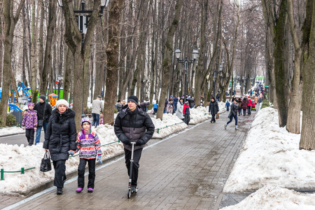 shrove: Winter 2015. Day. Russia. Moscow. Maslenitsa (pancake week). The Celebration of Maslenitsa (pancake week). The people are walking in the Park before starting entertainment program of the Holiday.