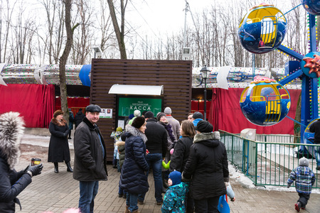 pancake week: Winter 2015. Day. Russia. Moscow. Maslenitsa (pancake week). The Celebration of Maslenitsa (pancake week). People in the queue to the checkout amusement Park.