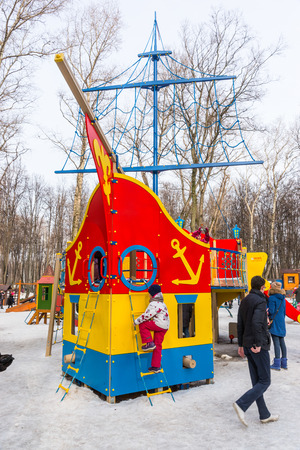 made in russia: Winter 2015. Day. Russia. Moscow. Maslenitsa (pancake week). The Celebration of Maslenitsa (pancake week). The playground for children in the Park. It is made in the form of a sailing ship. Children play on the Playground.