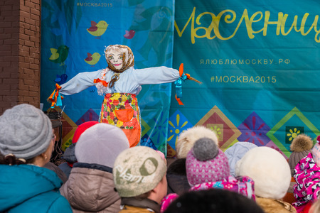 pancake week: Winter 2015. Day. Russia. Moscow. Maslenitsa (pancake week). The Celebration of Maslenitsa (pancake week). The concert in honor of the Holiday. People are watching the concert. The effigy of Winter on the stage.