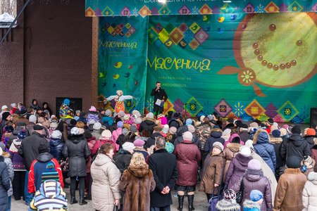 pancake week: Winter 2015. Day. Russia. Moscow. Maslenitsa (pancake week). The Celebration of Maslenitsa (pancake week). The concert in honor of the Holiday. People are watching the concert.