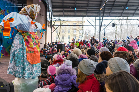effigy: Winter 2015. Day. Russia. Moscow. Maslenitsa (pancake week). The Celebration of Maslenitsa (pancake week). The concert in honor of the Holiday. People are watching the concert. The effigy of Winter on the stage.