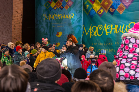 pancake week: Winter 2015. Day. Russia. Moscow. Maslenitsa (pancake week). The Celebration of Maslenitsa (pancake week). The concert in honor of the Holiday. The performance of the trained penguins with trainer on stage.