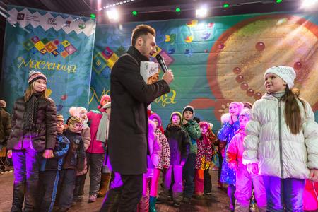 maslenitsa: Winter 2015. Day. Russia. Moscow. Maslenitsa (pancake week). The Celebration of Maslenitsa (pancake week). The concert in honor of the Holiday. The competition for children on the stage. The awarding of winners.