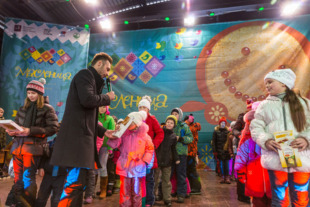 pancake week: Winter 2015. Day. Russia. Moscow. Maslenitsa (pancake week). The Celebration of Maslenitsa (pancake week). The concert in honor of the Holiday. The competition for children on the stage. The awarding of winners.